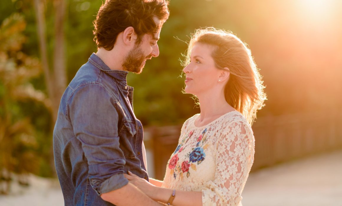 couple portrait with sunset flare