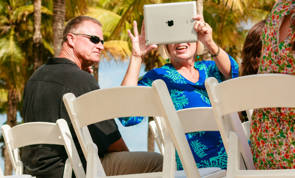 a wedding guest with an ipad